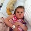 Allie in hospital bed with Duckie and Blankie.
